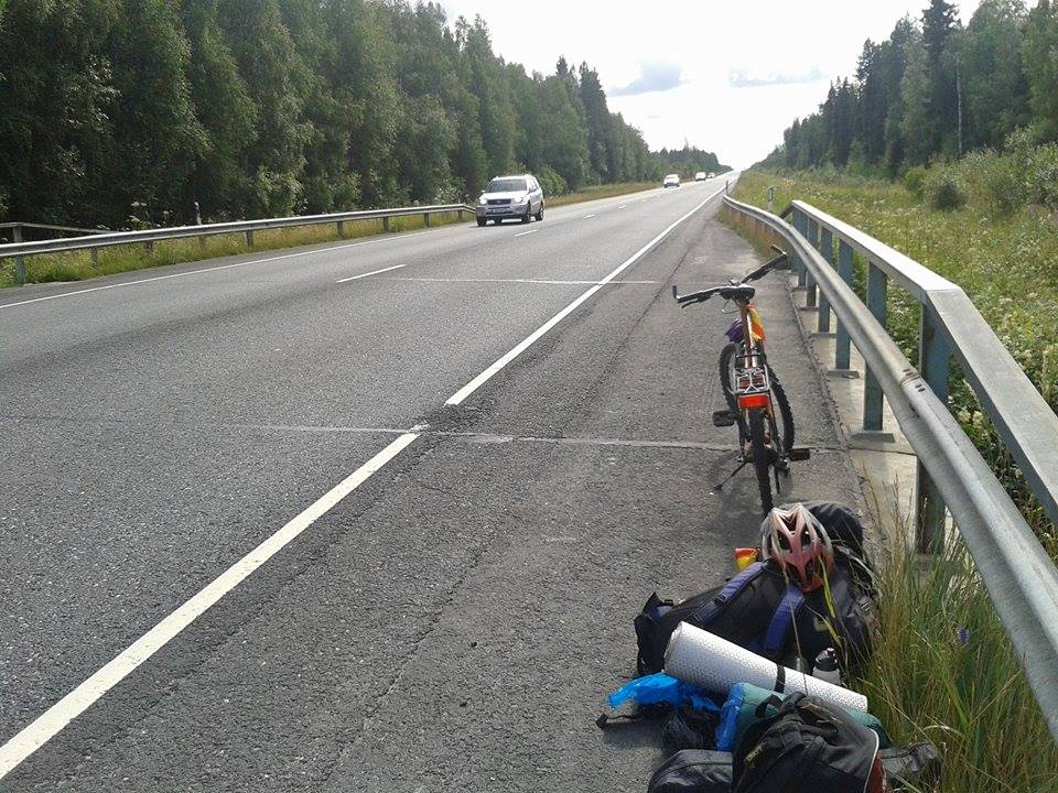 This is me fixing my bicycle in the middle of the road.