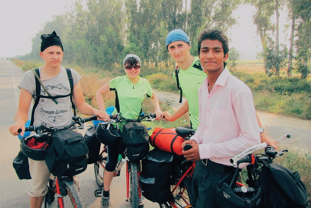Kaspars brother, Una and Kaspars cycling in India.