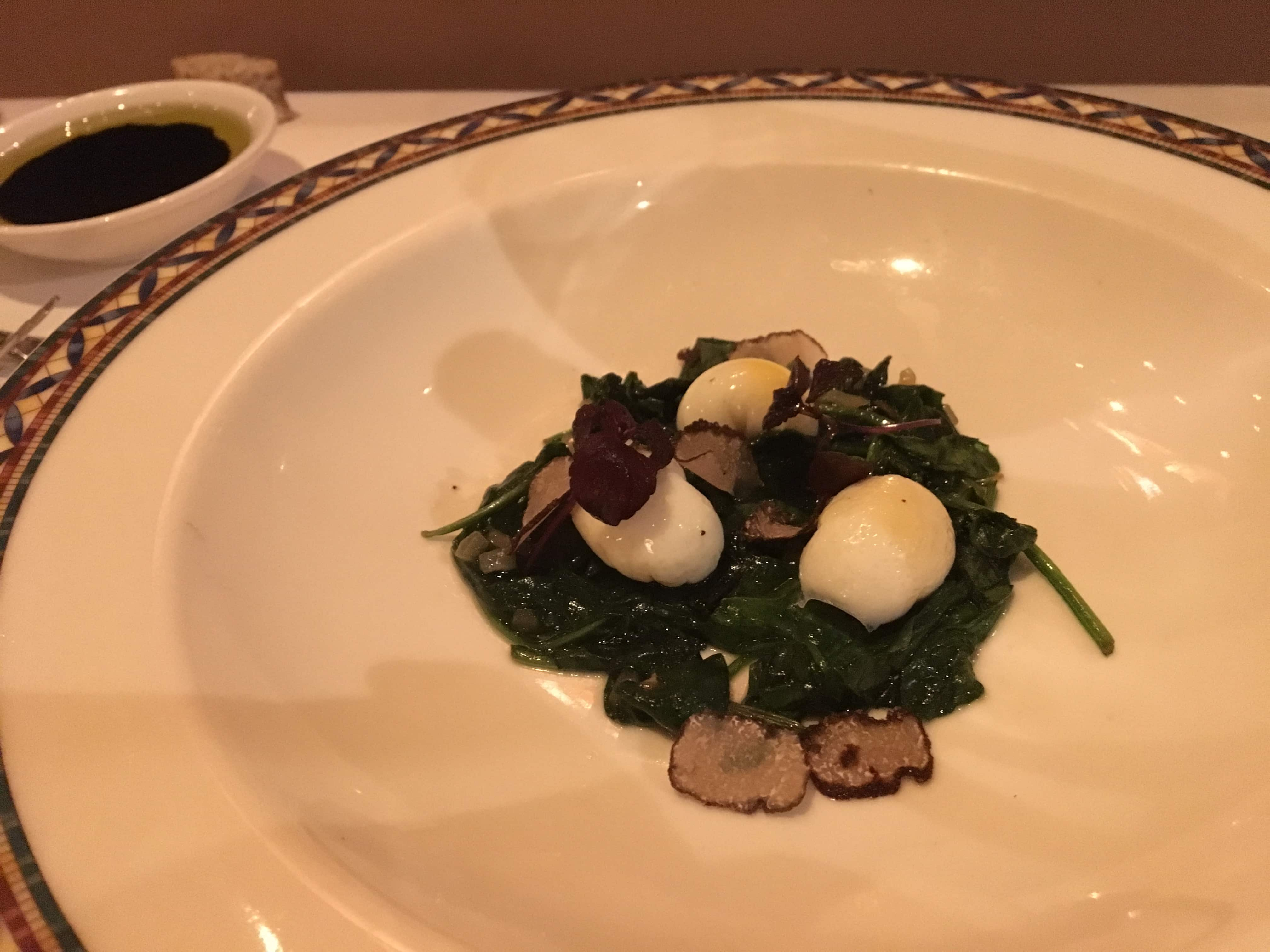 Poached Quail Eggs with Saute Spinach and Sliced Fresh Truffle